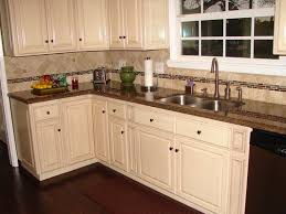antique white kitchen cabinets a s tile subway tile backsplash to go with tropical brown granite and off white