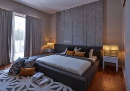 master bedroom feature wall: master bedroom grey paneled design feature wall combined with timber flooring and stylish lightcraft bedside table