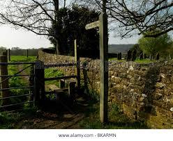england style steps:  surrey england wotton public footpath style by wall of st john the evangelist church graveyard