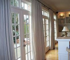 kitchen patio door window treatments ideas interior bamboo roll up shade hanging on white wooden door frame combi