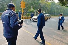 photo essay  we are odd  our neighbour is even   livemint    surrounded  the traffic police checking for violations near kasturba gandhi marg on  january