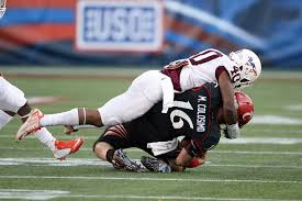 u s department of defense photo essay virginia tech linebacker deon clarke tackles cincinnati quarterback michael colosimo during the fourth quarter of the
