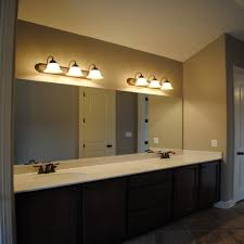 bathroom lighting ideas double vanity modern vanity plus vanity sconces and dark wood flooring for modern bathroom lighting ideas double