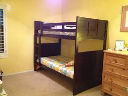 black wooden bunk bed on mocha carpet connected by cream wall scheme astounding bunk beds for astounding modern loft bed