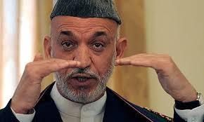 Hamid Karzai in Kabul. Photograph: Shah Marai/AFP/Getty Images. 6.50am: Karzai has appeared in a dark green robe and his trademark hat. - Hamid-Karzai-in-Kabul-001