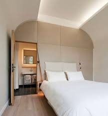 curved ceiling design with integral ambient lighting hotel room in an old priory designed ceiling ambient lighting