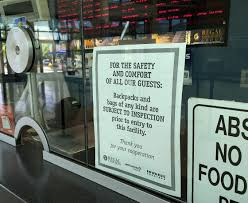 regal theaters check bags backpacks under new security measures a sign on the regal cinemas ticket window at citrus park mall that references security measures