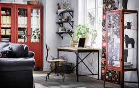 living room desks furniture: industrial style desk and swivel chair in pine black in a living room with red