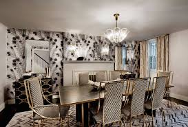 black and white dining table set: black and white dining chairs dining room fireplace peacock feathers wallcovering black and white chairs