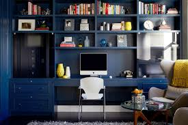 harlem apartment contemporary study room idea in new york with blue walls dark hardwood floors and blue home office dark wood