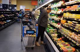 why wal mart is betting big on being your local urban grocer wunc a customer shops for groceries her son at the wal mart on h street in washington d c