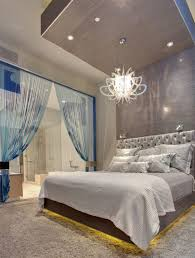 image of fancy cool bedroom lighting ideas of led recessed puck lights alongside contemporary white chandeliers artistic bedroom lighting ideas