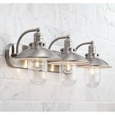 this bathroom light features clear glass for bright and stylish illumination bathroom lighting designs 69 bathroom lighting design