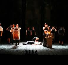 neil bartlett production romeo and juliet royal a w kneels over a man on the floor while some others kneel around them