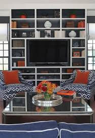 speed blue living accents clip blue and orange living room features a mirrored waterfall cocktail tab
