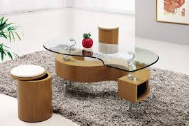 lacquered oak dining table metal legs glass top combined with light brown wooden shelf connected with silver