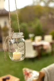 light up an outdoor party as the sun goes down with tea lights in mason jars adore diy hanging mason