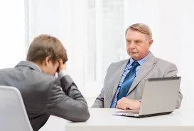 Image result for image of a manager with employee in the office