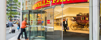 wells fargo teams continue remediation work under settlement a customer enters a wells fargo branch in new york
