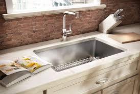 undermount kitchen sink stainless steel: undermount kitchen sink styles with knife holder on marble countertop under brick backsplash ideas