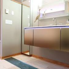 white kitchen windowed partition wall: modern neutral bathroom with wood floor