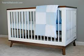 designing your babys nursery choosing the right bedding and crib heart of deborah baby nursery cool bee