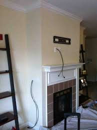 Hide Tv In Wall Concealing Wires In The Wall Over The Fireplace Before The Tv Is