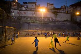 gorgeous photos of kids playing soccer in s slums soccer in