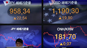 world stocks rebound as soothes yuan weakness fears naples an employee is seated as screens showing foreign exchange rates are displayed at a bank in