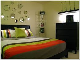 bedrooms beauty circular wall decor in fascinating cheerful green orange themed bedroom interior design with masculine bedroom furniture interior fascinating wall