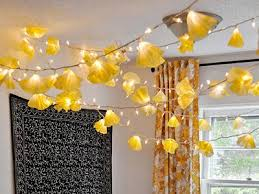 the coffee filters act as little textured paper shades for white christmas lights subtle ombre color is achieved by dipping them in food coloring or cheap diy lighting