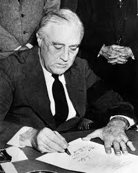 rhetorical analysis franklin delano roosevelt pearl harbor english united states president franklin d roosevelt signing the declaration of war against