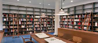 tall library shelving for book storage along wall bookcase book shelf library bookshelf read office