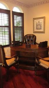 kidney shaped desk home office traditional with classic design kidney shaped desk shutters wood floor baseboards ceiling fan