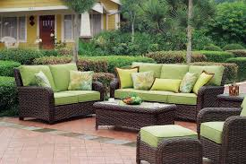 comfortable outdoor seating idea with best patio furniture brands of rattan sofa with green bolster and best wood furniture brands