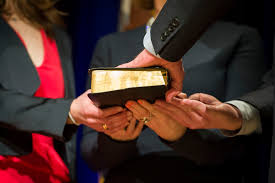 u s department of defense photo essay defense secretary ash carter places his hand on a bible his family members hold as supreme