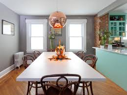 casual transitional dining room with copper light pendant hgtv copper living room casual dining room lighting