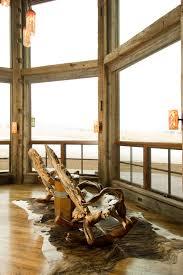 gliding rocking chair family room rustic with animal skin rug large window orange sconce pendant lighting baby nursery rockers rustic