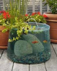 diy patio pond:  fascinating low budget diy mini ponds in a pot