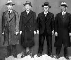 「On February 14, 1929, four men disguised as police officers enter mobster Bugs Moran's headquarters in Chicago, line up seven of his henchmen, and shoot them to death.」の画像検索結果