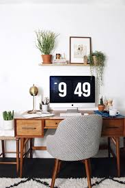 at home with new darlings featuring the west elm saddle chair and mid century desk chic home office bedroom