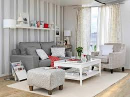 For Floating Shelves In Living Room Grey Couch And Floating Shelves Using Striped Wallpaper For