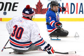 u s department of defense photo essay ralph dequebec of the usa warriors sled hockey team flips a puck past a teammate while