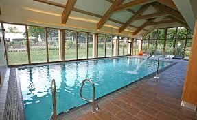 wonderful white brown wood glass stainless cool design indoor pool residential rectangular shape pool stainless stairs awesome white brown wood glass modern design