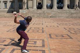 adam habib wits is reaching a point of no return groundup photo of protester throwing stone