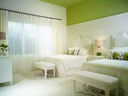 annalisa at mediterra tropical guest bedroom idea in other with green walls and carpet bedroom paint colors feng