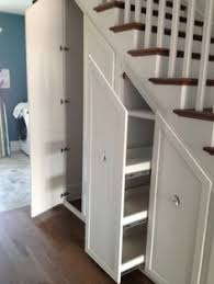 kitchen solution traditional closet: entryway beside staircase of cool coastal living showehouse is tight but owner doesnt