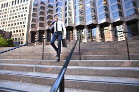 reasons for leaving a job good and bad businessman walking down steps by an office block