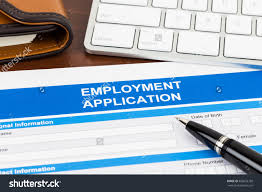 employment application form pen and keyboard document is save to a lightbox