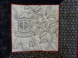"""I love it when machine quilting is combined with embroidery-what a sweet detail! Detail-""""Sashiko Shadow Box"""" made by Claudia Norman quilted by Susan Krinks. - dscn1855_edited-1"""